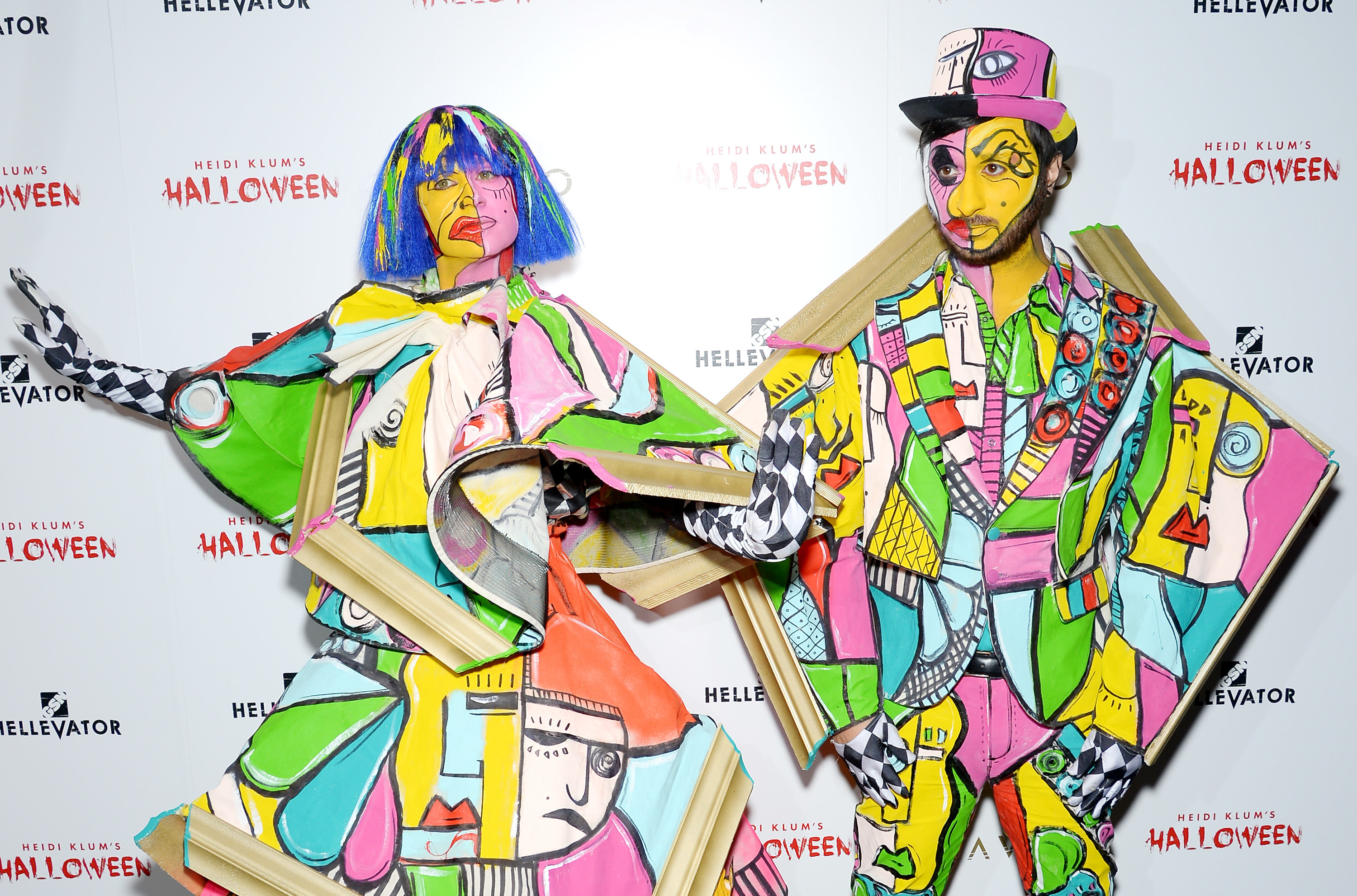 Christian Siriano and a man in wildly geometric costumes that look like cut up paintings.