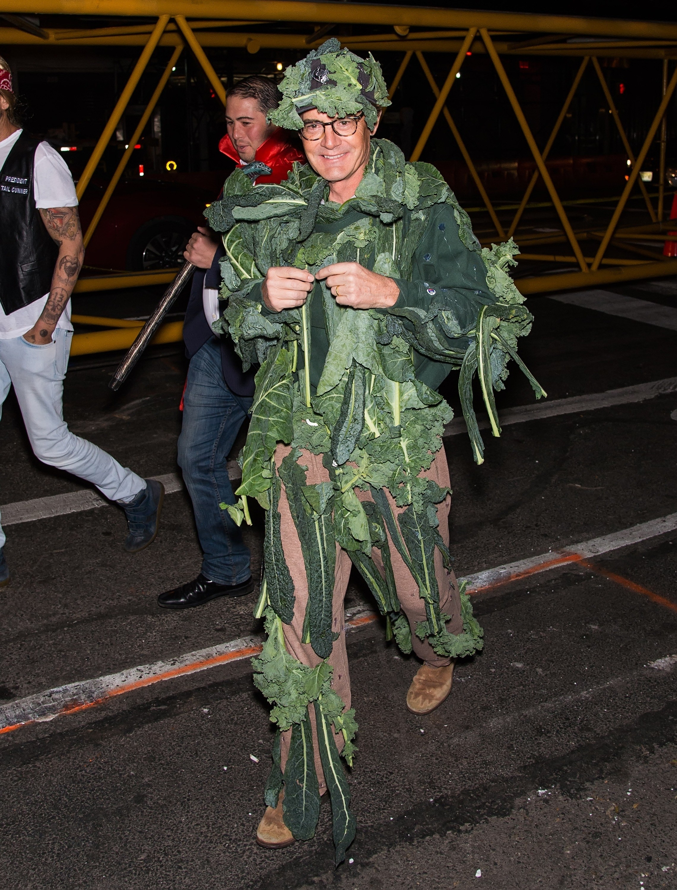 Kyle MacLachlan dressed in a suit with lots of kale pinned to it.