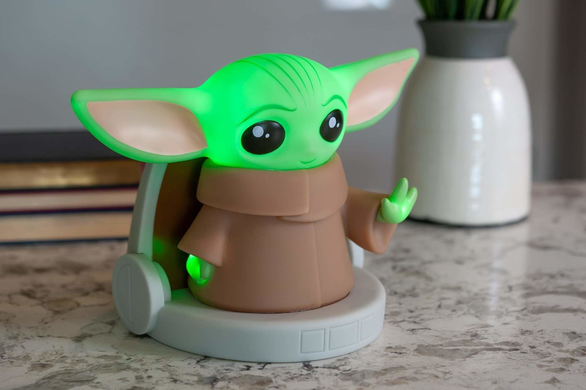 The seven-inch lamp shaped like a cutesy Baby Yoda in his pod