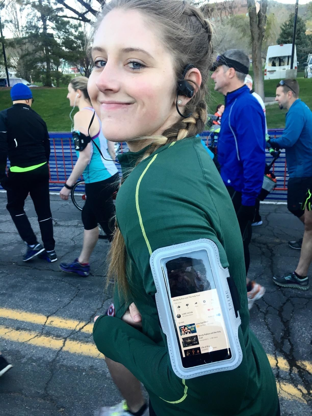 Reviewer wears light blue armband while running a marathon