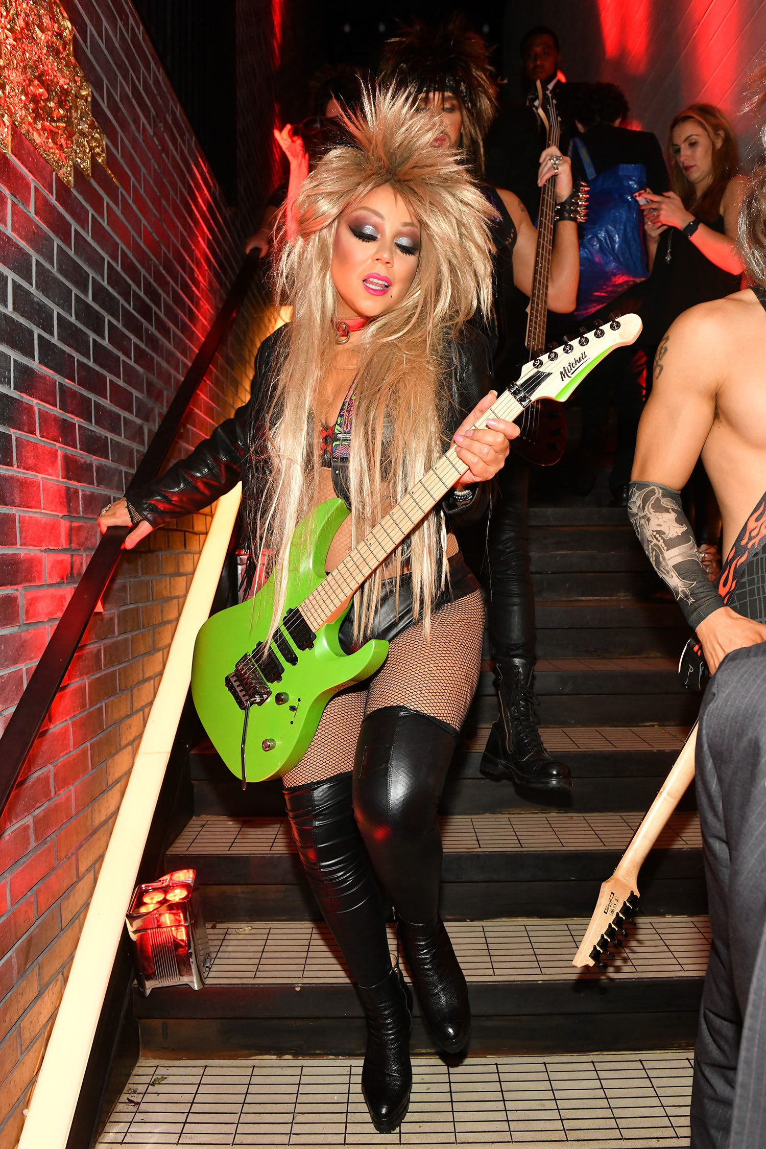 Mariah Carey dressed as a punk rocker on a staircase.