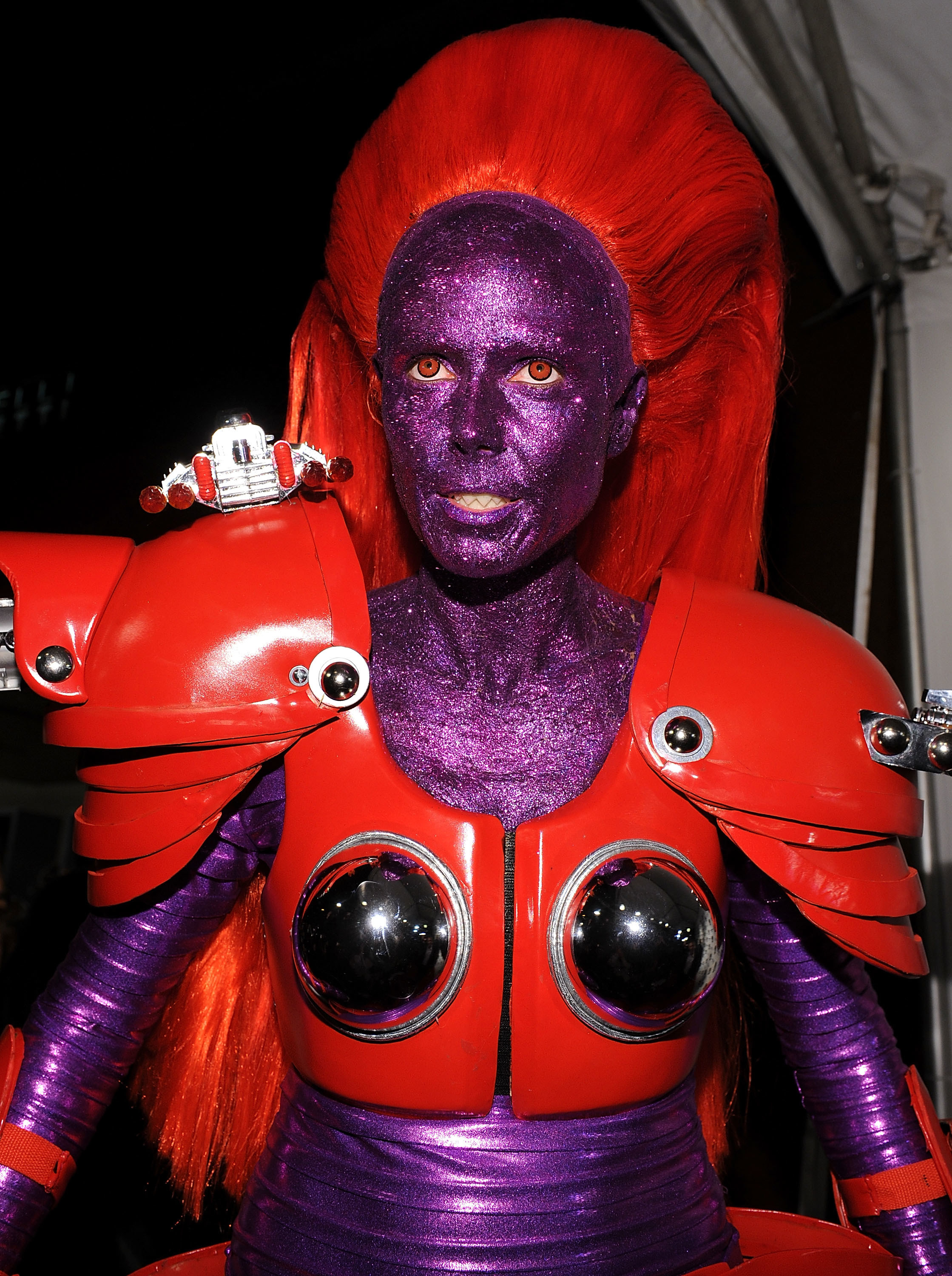 Heidi Klum dressed as a robot transformer in purple and red.