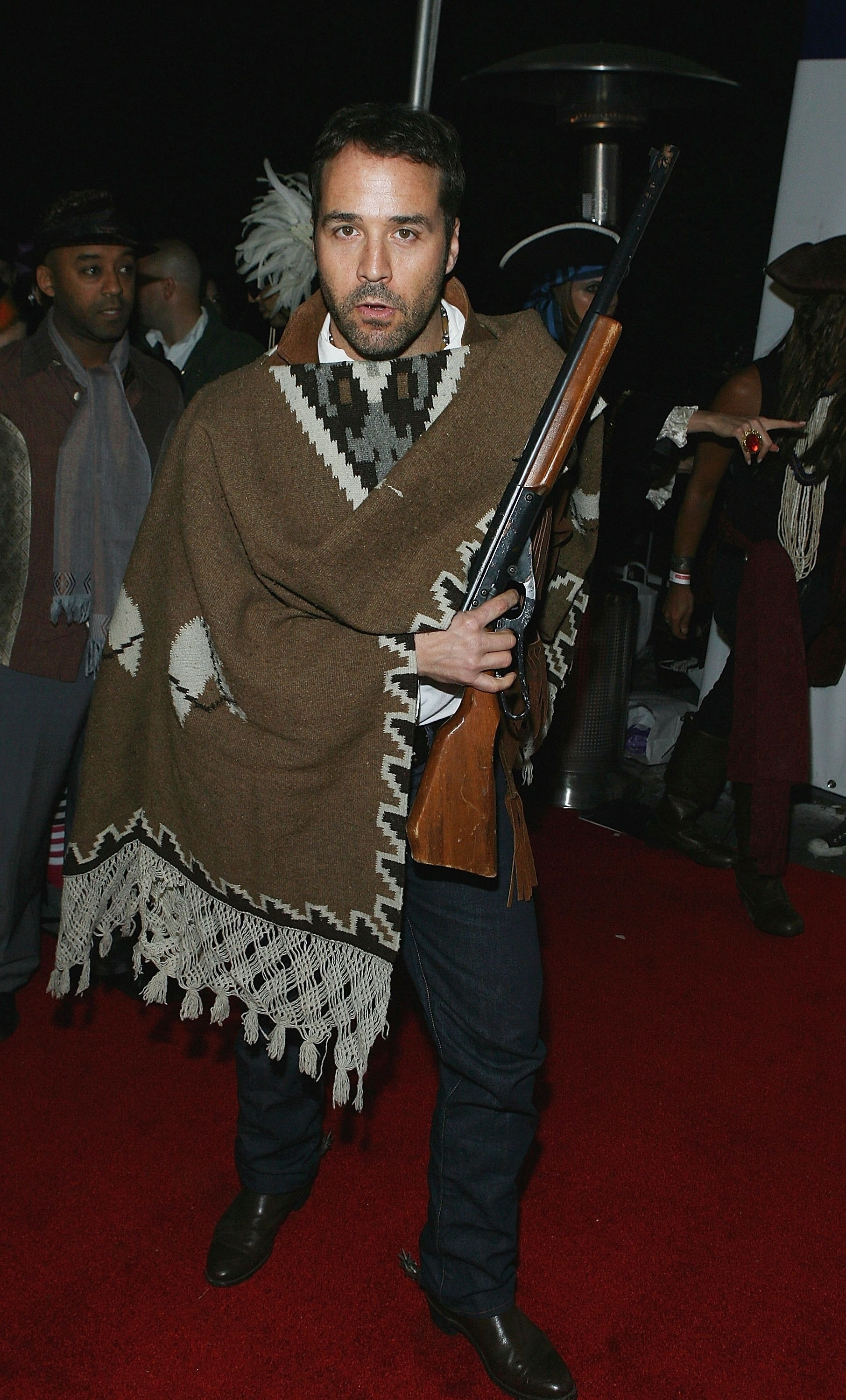 Man dressed like Tuco from The Good, The Bad, The Ugly (poncho and western boots).