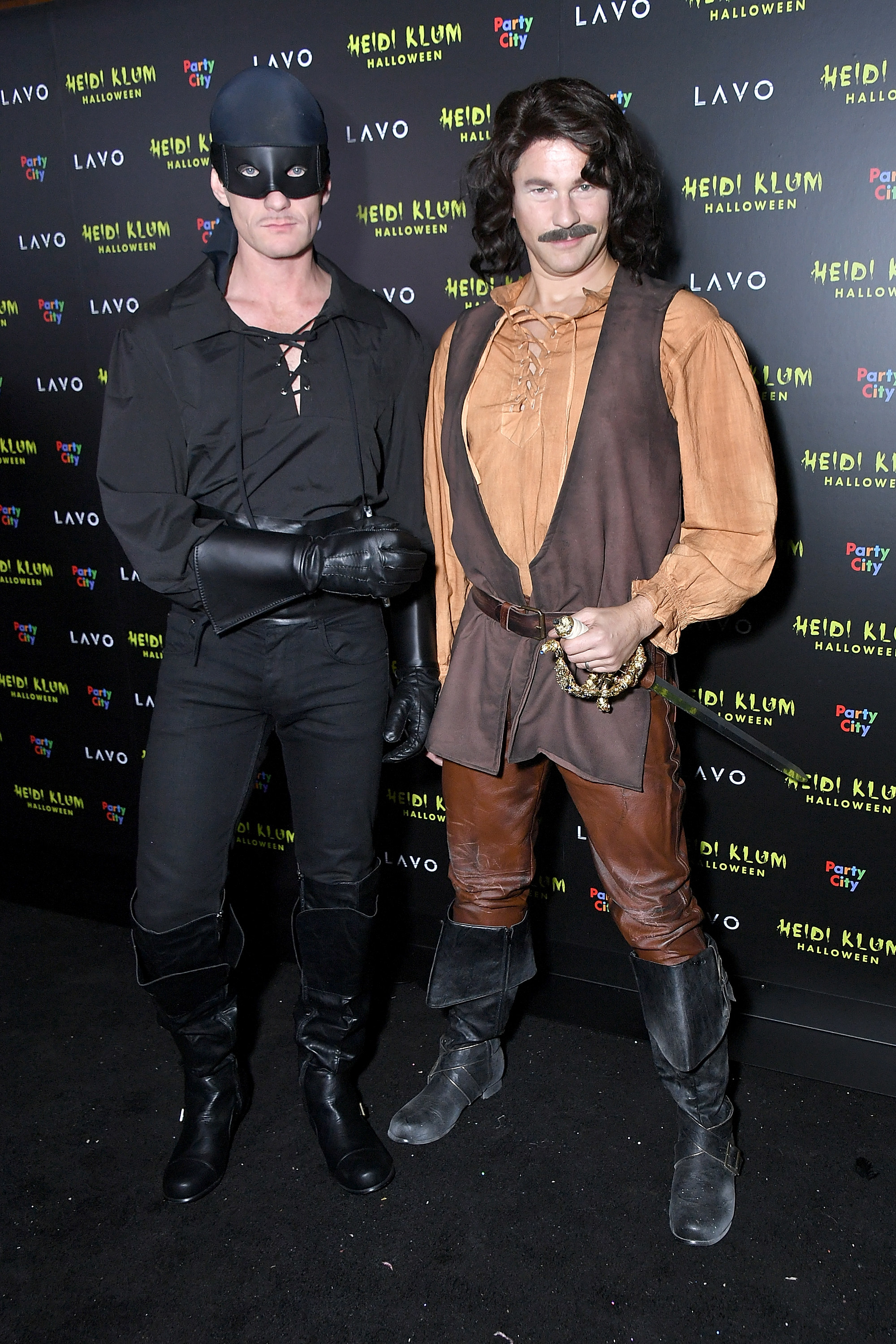 Two men dressed in costumes.
