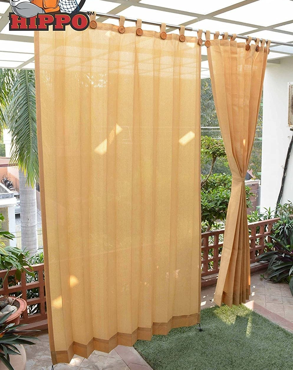 Curtains hung on a balcony providing shade from the sun.