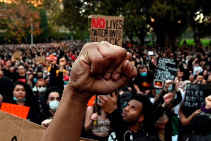 A hand raised in the Black Lives Matter Symbol at a protest