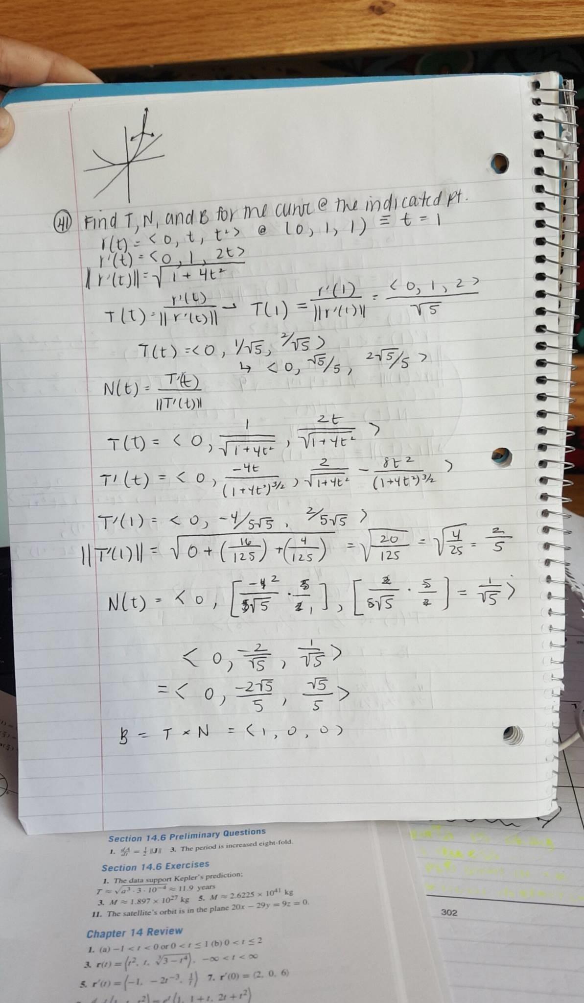A student holds up their notebook, showing their handwritten math homework