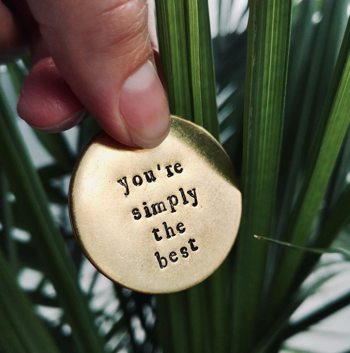 "A keychain that says, ""simply the best"""