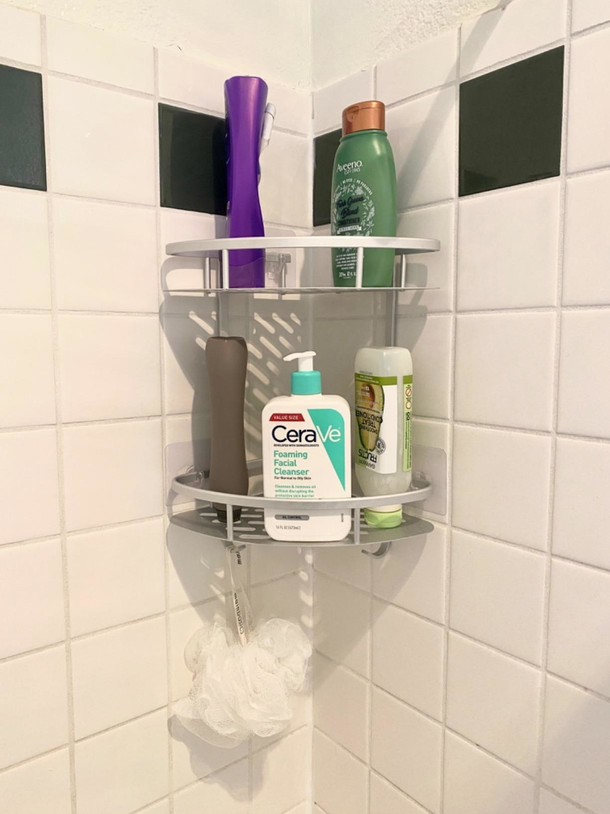 Reviewer photo of the shelf holding toiletries and a loofah