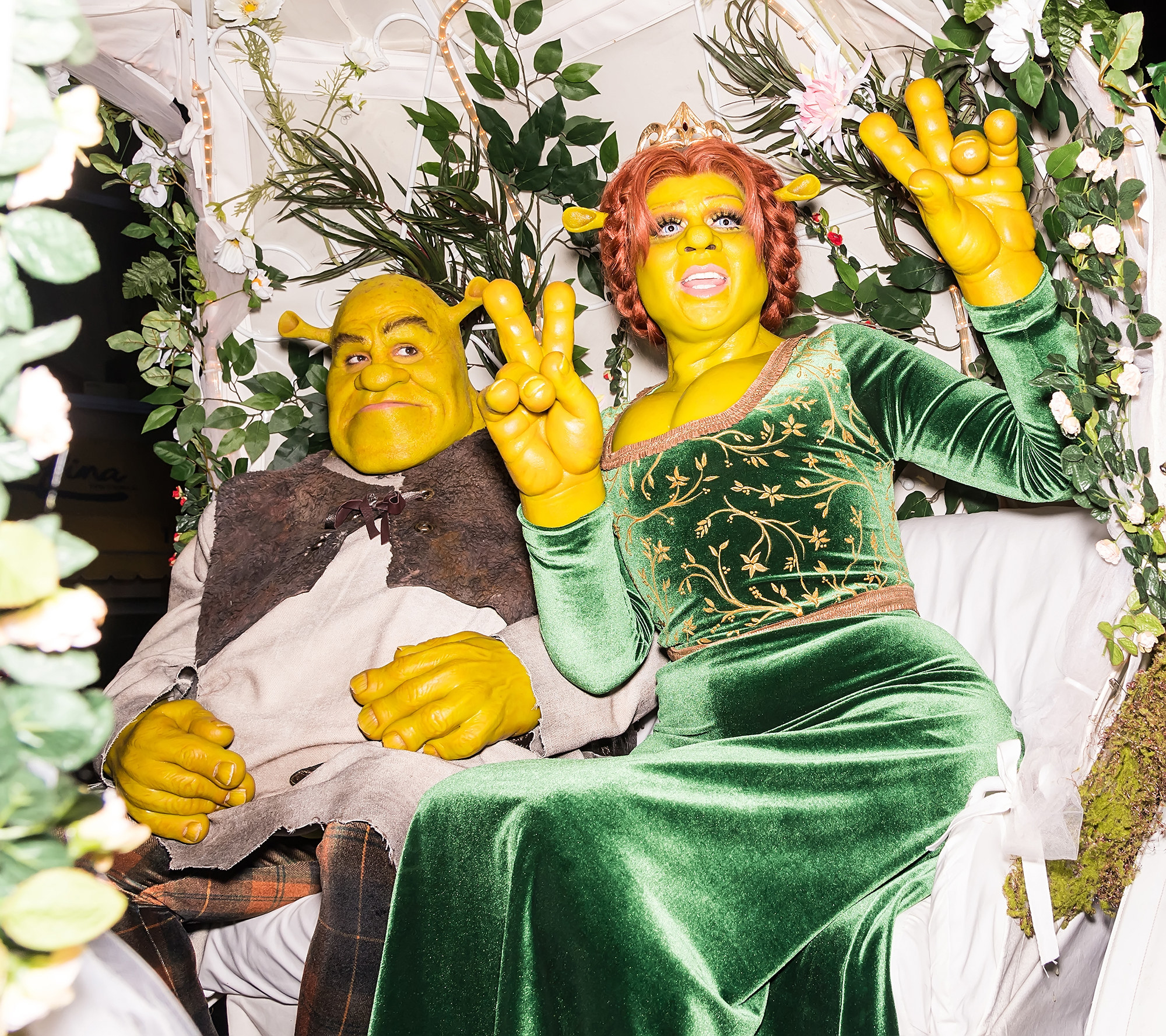 Two people dressed as Shrek and Princess Fiona