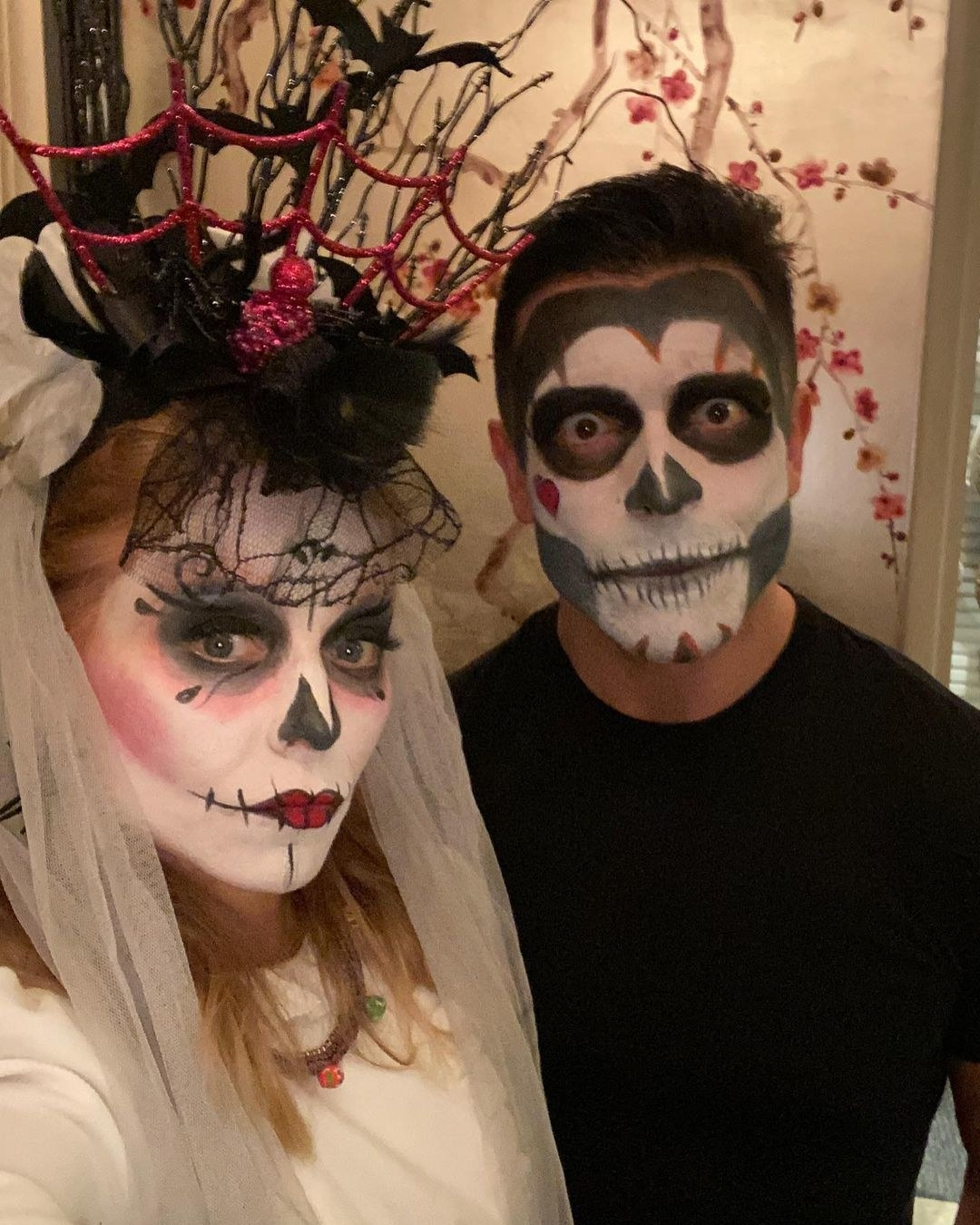 Kelly and Mark dressed as skulls for Halloween