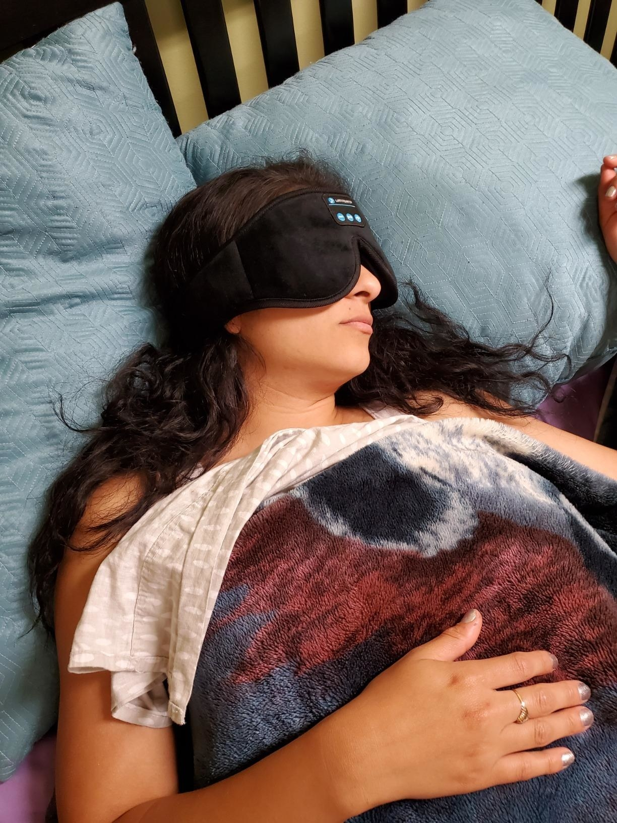 Reviewer in the black sleep mask