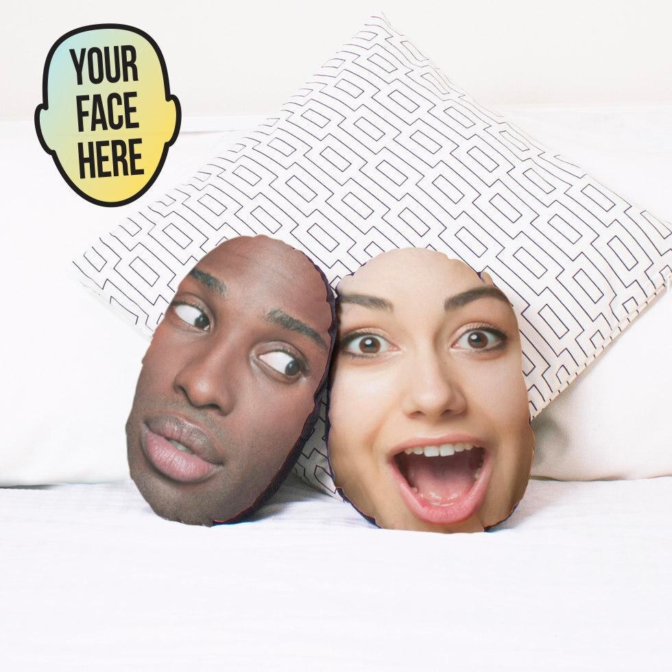 Two oval cushions with a person's face on each one