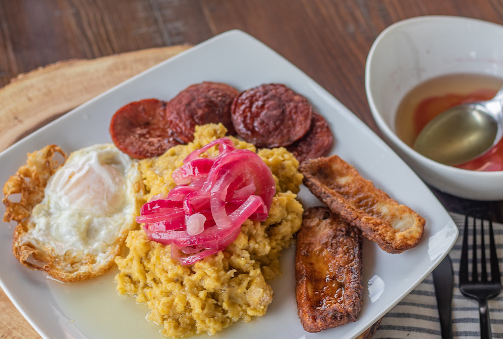 A plate of los tres golpes: salami, eggs, fried cheese, and mashed plantains.