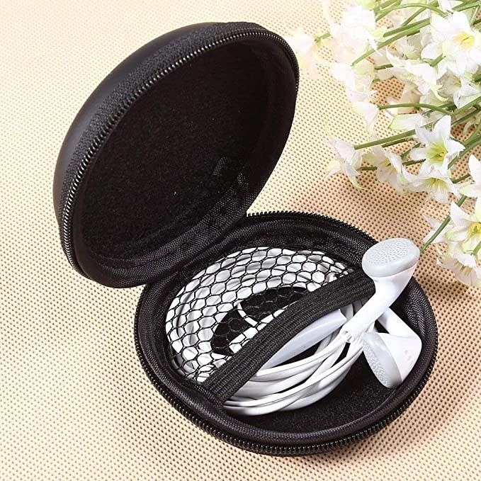 Black carrying case with white earphones in it.