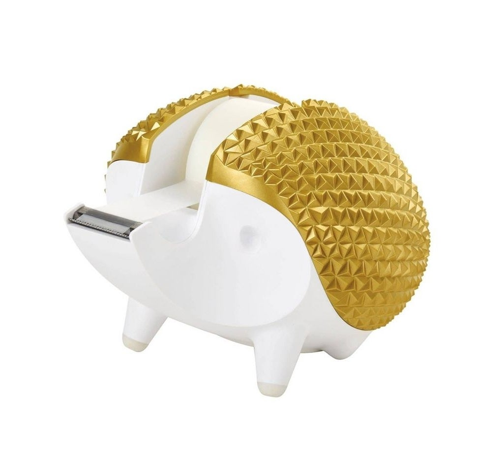 """A small plastic tape dispenser, shaped like a hedgehog with the tape coming out of the nose area; body is white and """"quill"""" area is gold"""