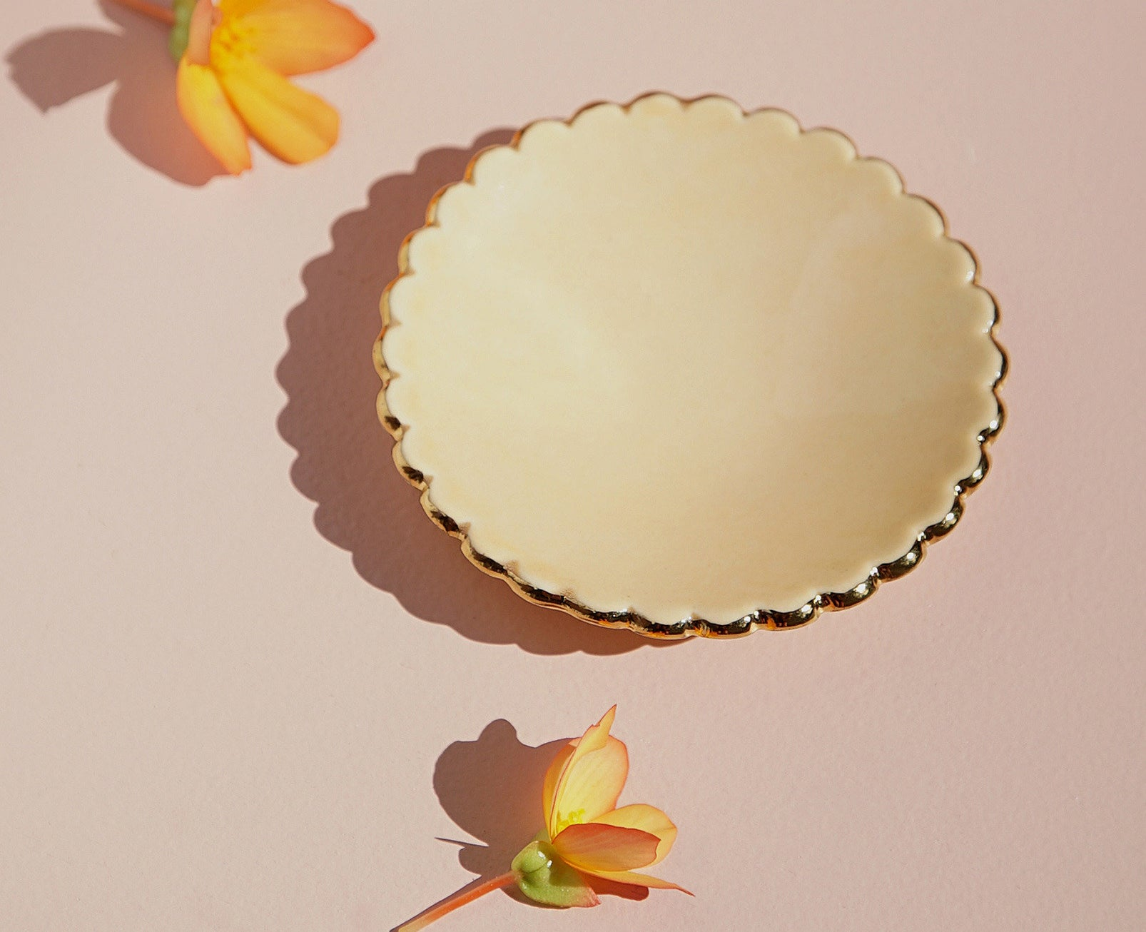 A small ceramic dish with scalloped edges