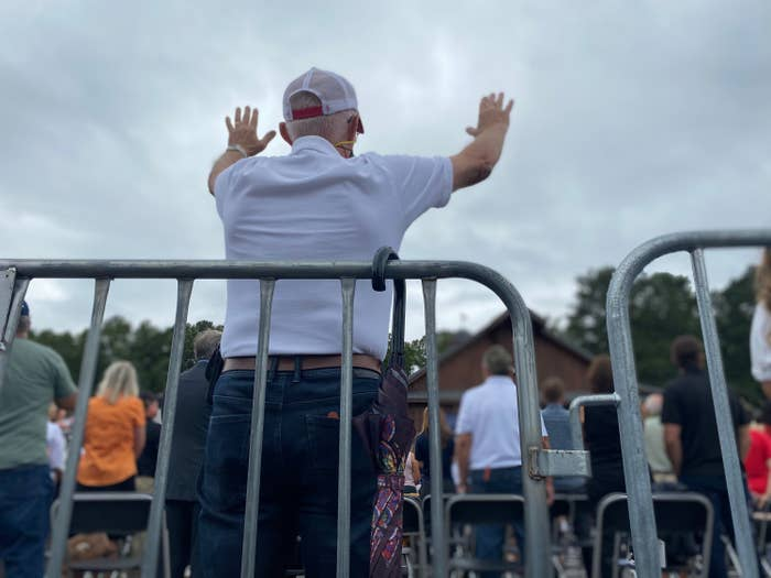 An attendee stands with his arms raised at an Evangelicals for Trump event in Georgia last month