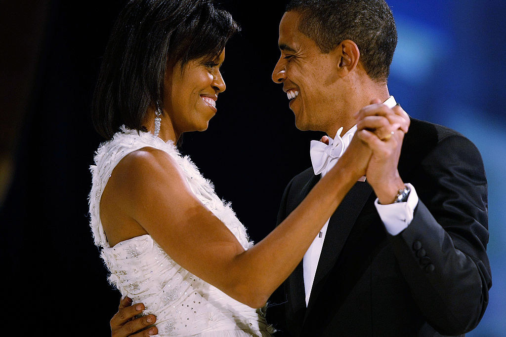 Michelle and Barack smiling and dancing together