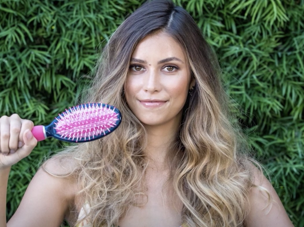 Model shows right side of hair after brushed with Conair De-Poof brush