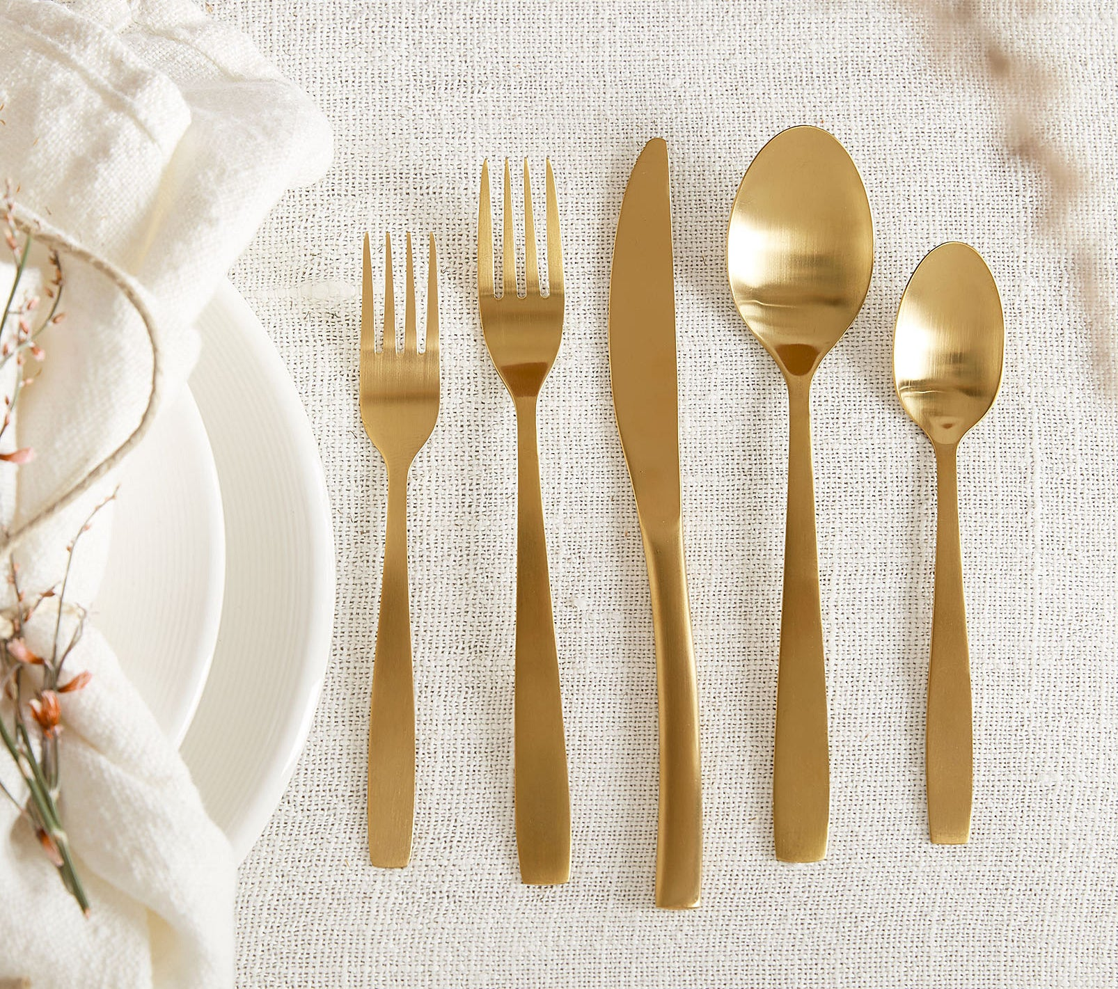 A set of gold cutlery on a table