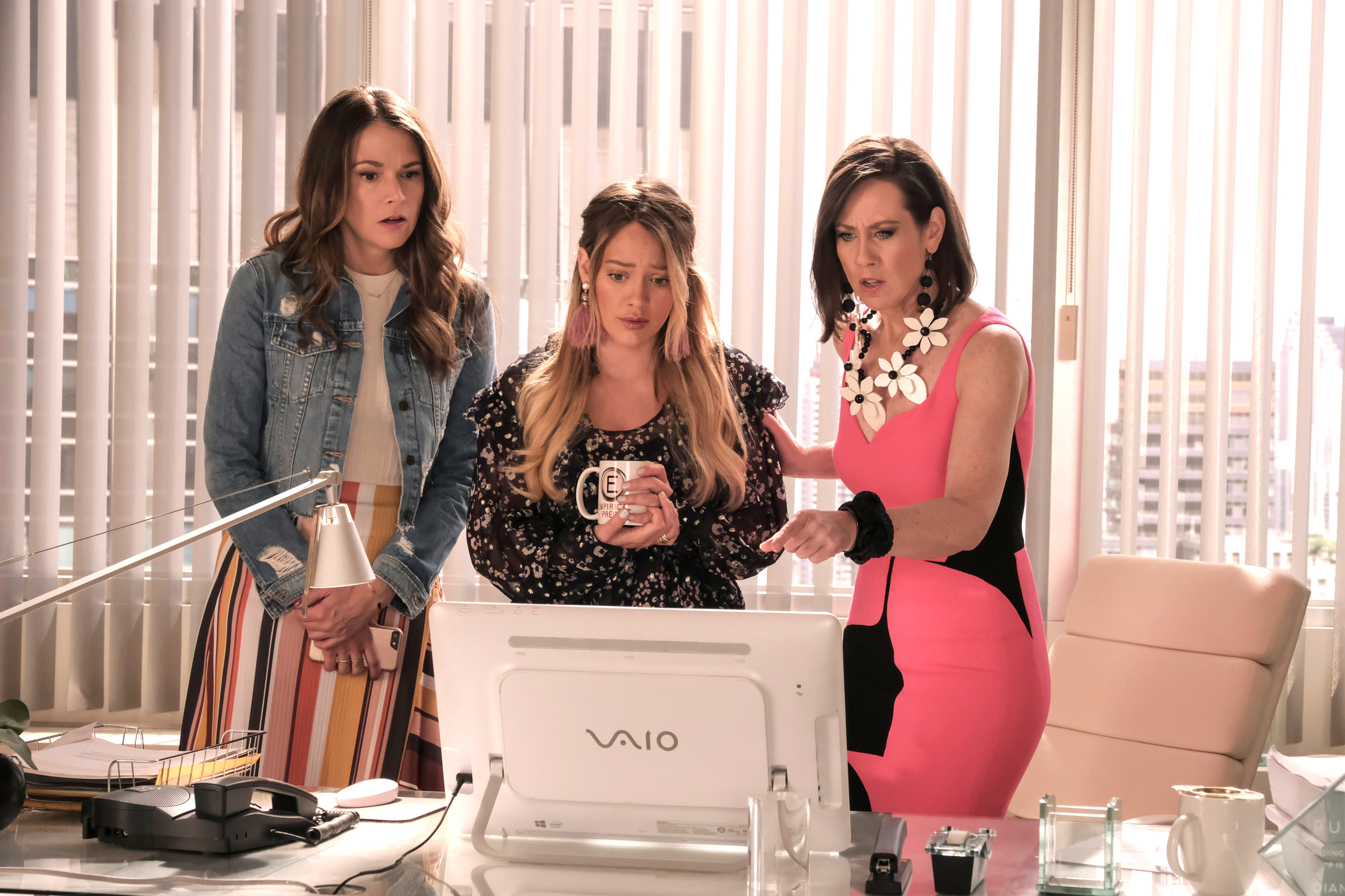 "Liza, Kelsey, and Diana looking at a computer screen in ""Younger"""