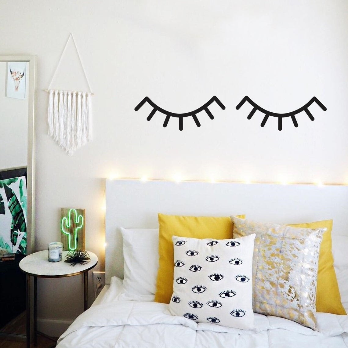 The sleepy eye wall decals above a bed