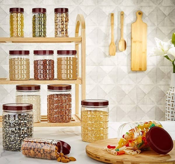 The jars displayed with food in them.