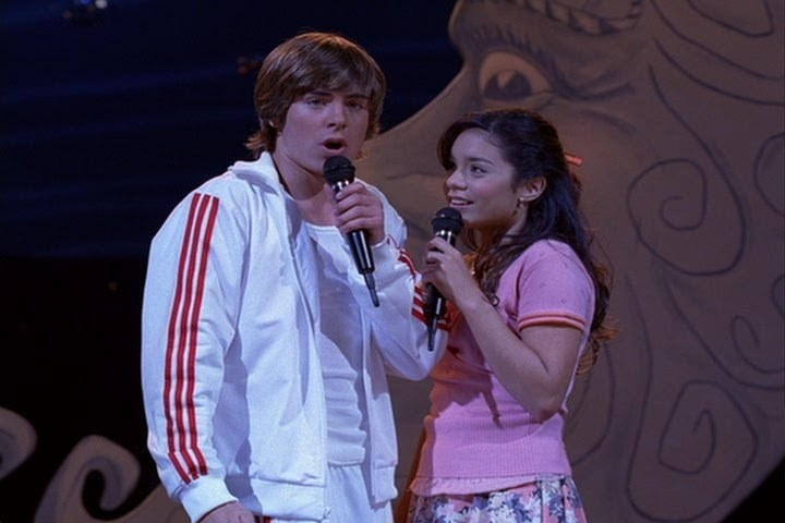 Troy and Gabrielle on stage singing together