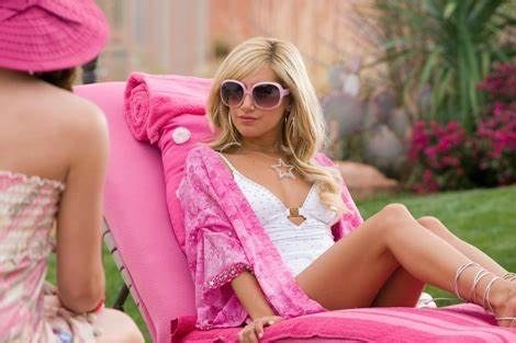 Sharpay sitting by the pool looking very luxurious