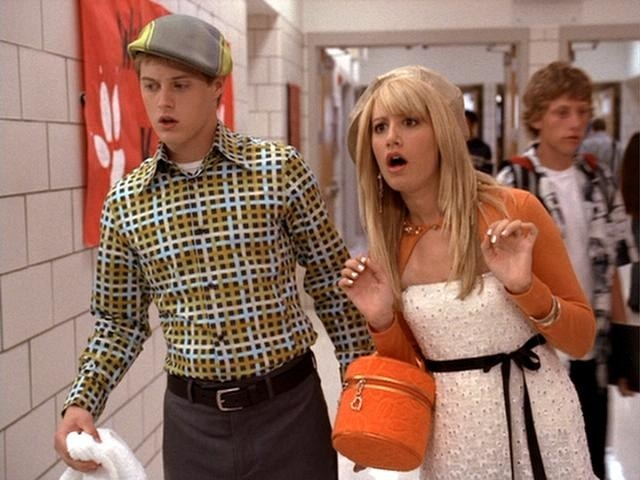 Sharpay and Evan in the school hallway looking bewildered at the callback list