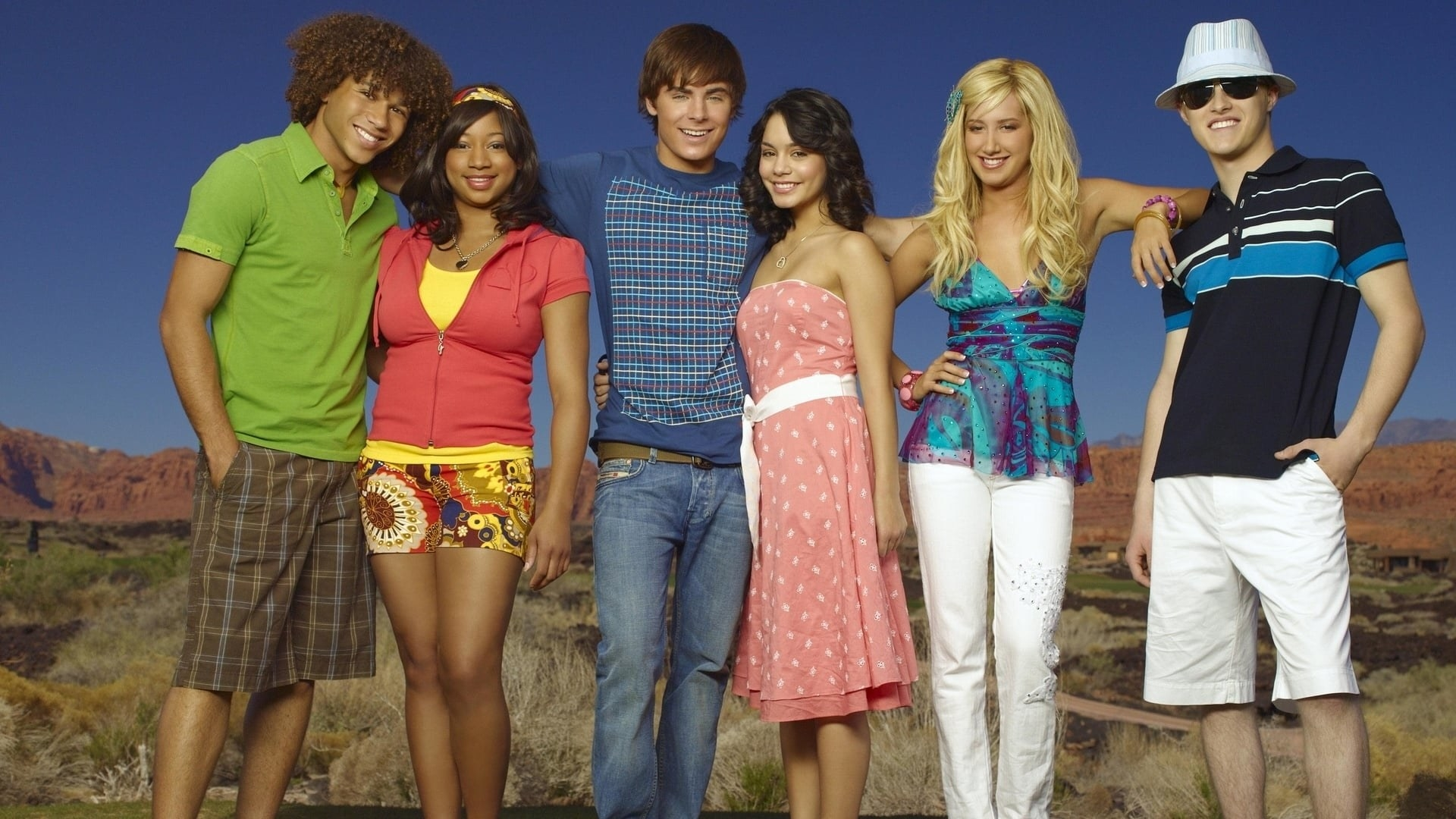 The cast of High School Musical 2 about to jump into a pool together