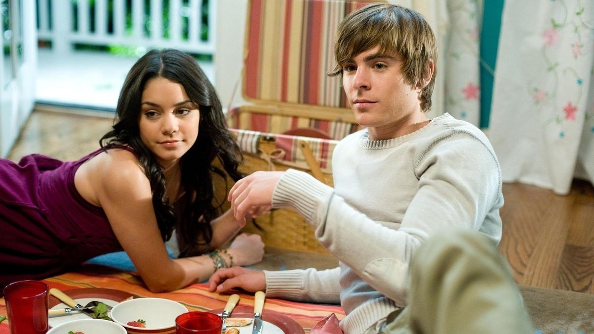 Gabriella and Troy having a picnic together