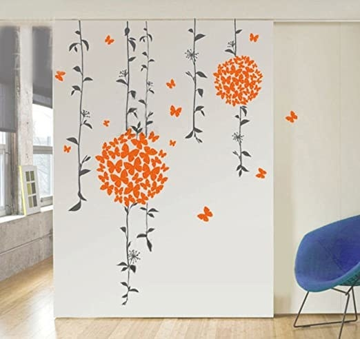 A decal with green vines with bursts of orange butterflies huddled together.