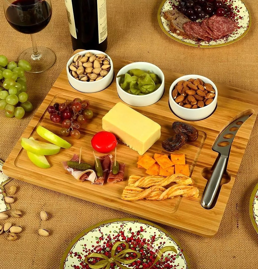 A charcuterie board with slots cut out for three bowls and a cheese knife