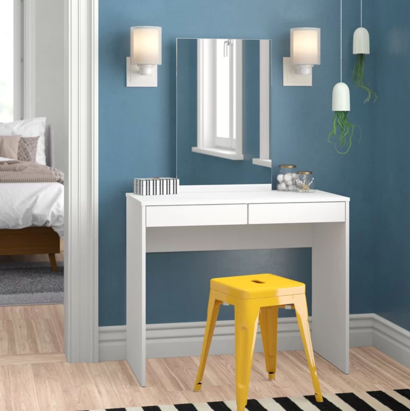 The vanity with a mirror attachment with a yellow stool