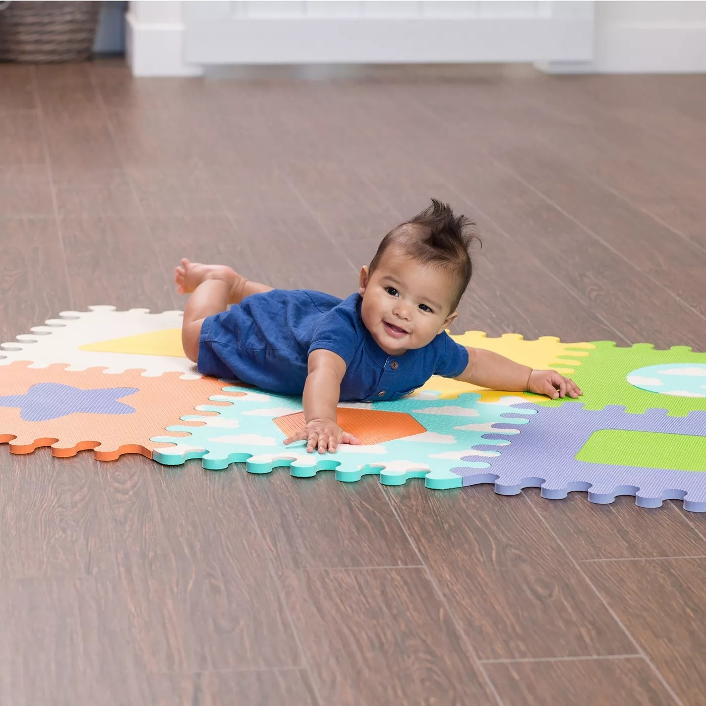 A baby on a foam puzzle mat
