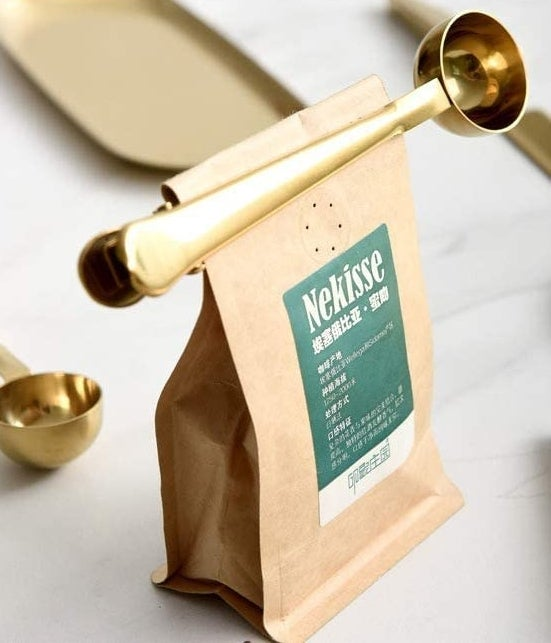 A coffee spoon doubles as a clip to keep a coffee bag closed