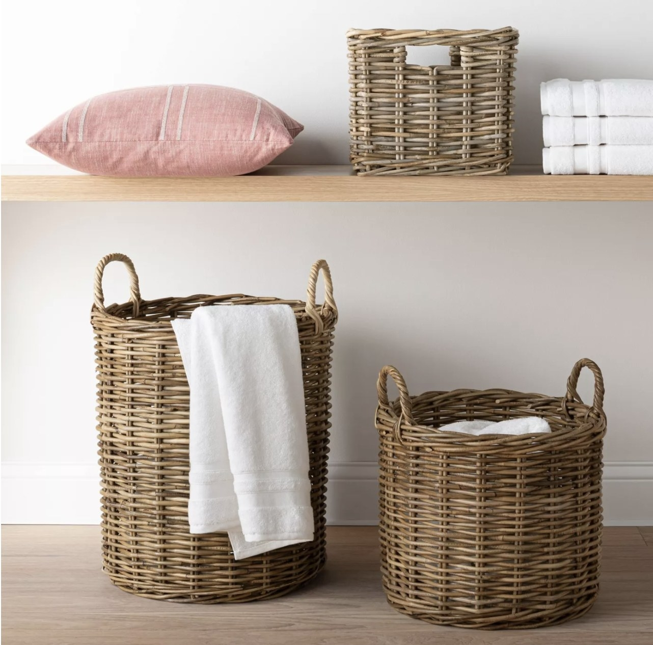"The round rattan baskets in 16"" x 14"" and 18"" x 18"" storing towels"