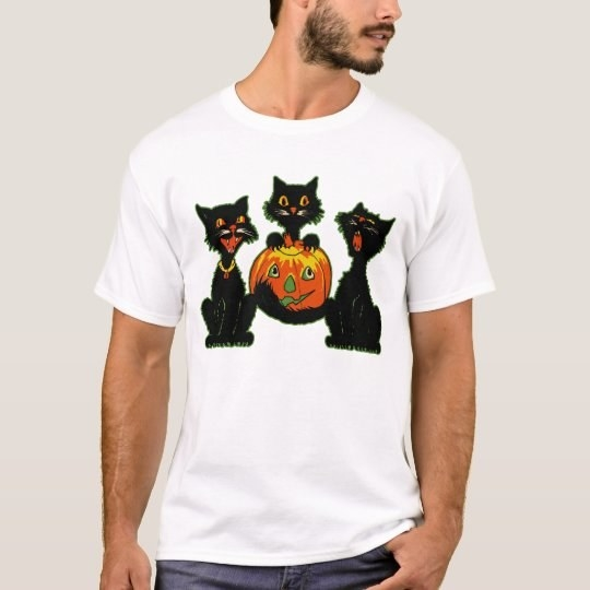 a model wearing a white tee with three black cats and a pumpkin
