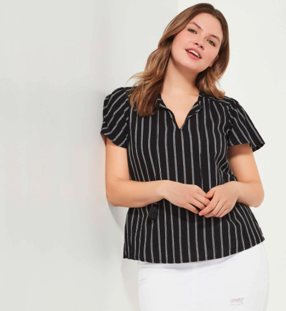 A model wearing a short-sleeves black shirt with pinstripes