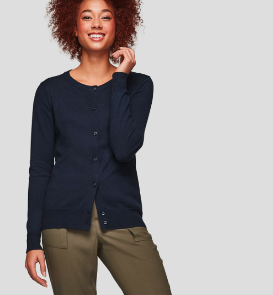 A model wearing a navy button-up cardigan