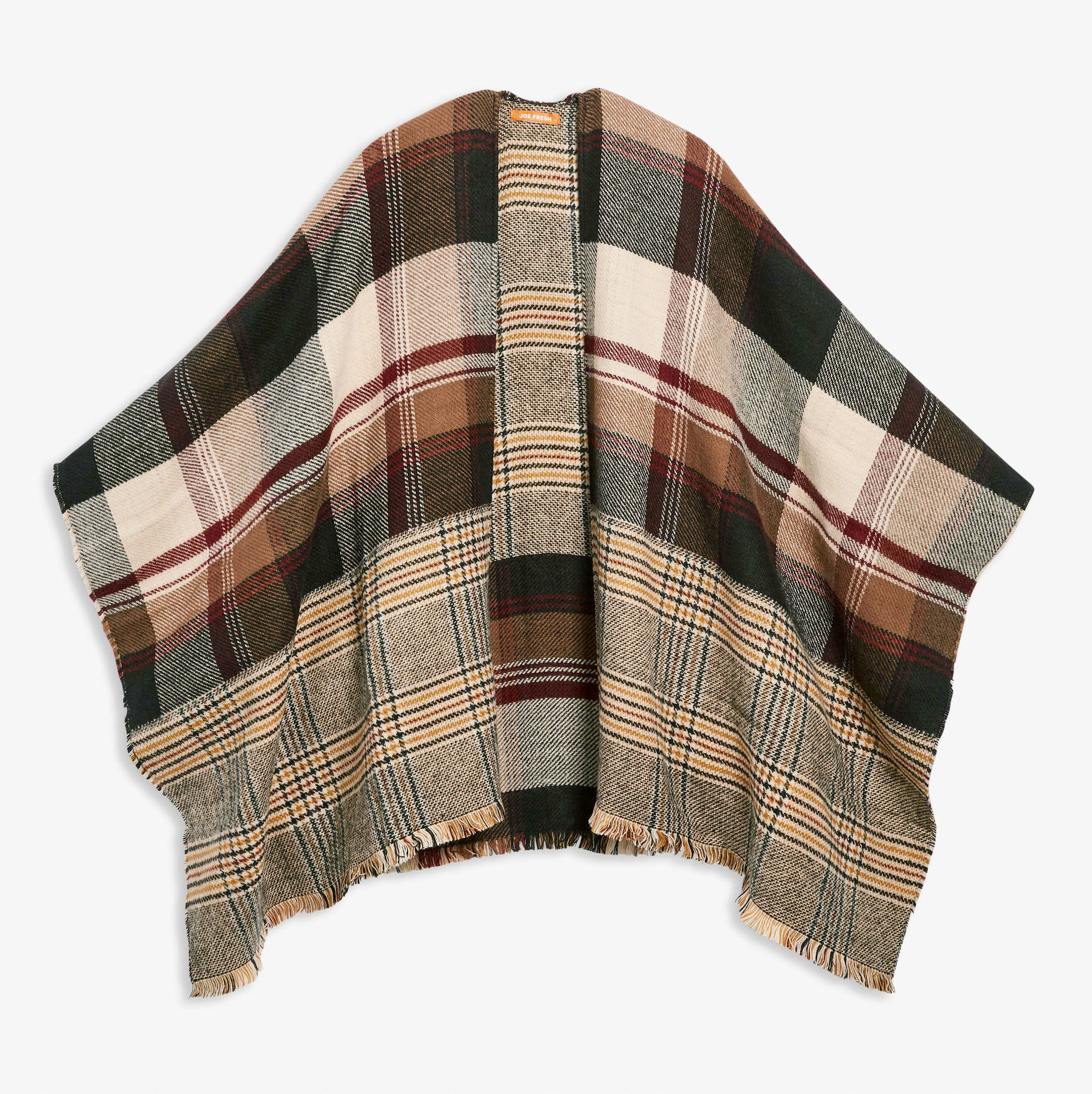 A reversible knit poncho with different plaid patterns