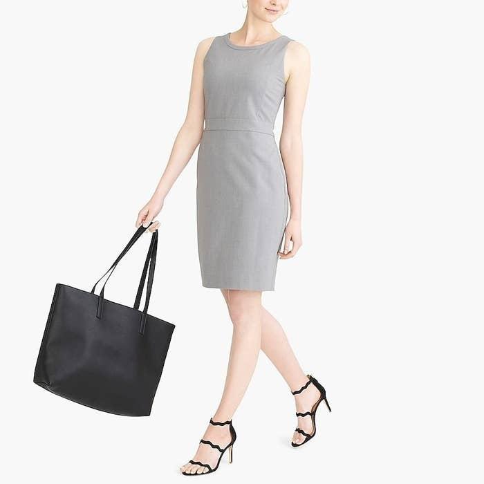 Gray sleeveless dress that hits slightly above the knee