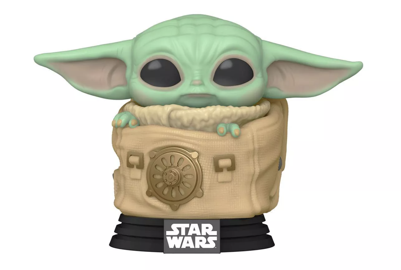 baby yoda in a tiny pouch