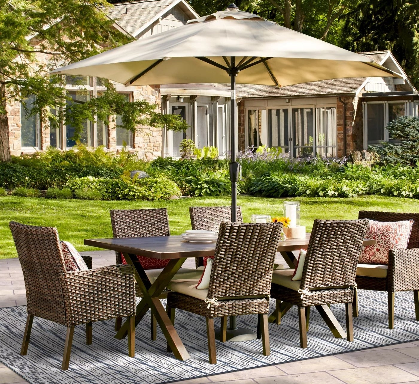 The wicker dining chairs with tan cushions