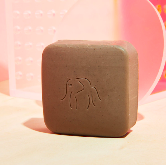 A close up of the exfoliating bar on a vanity