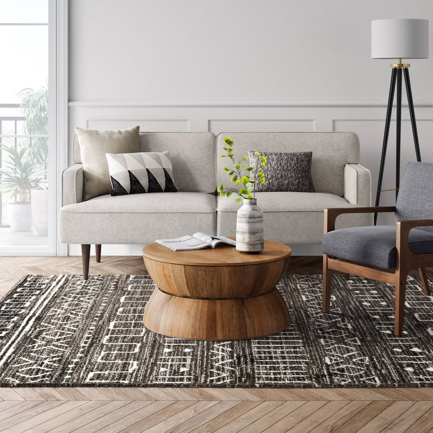 tribal printed black and white rug in the middle of a living room