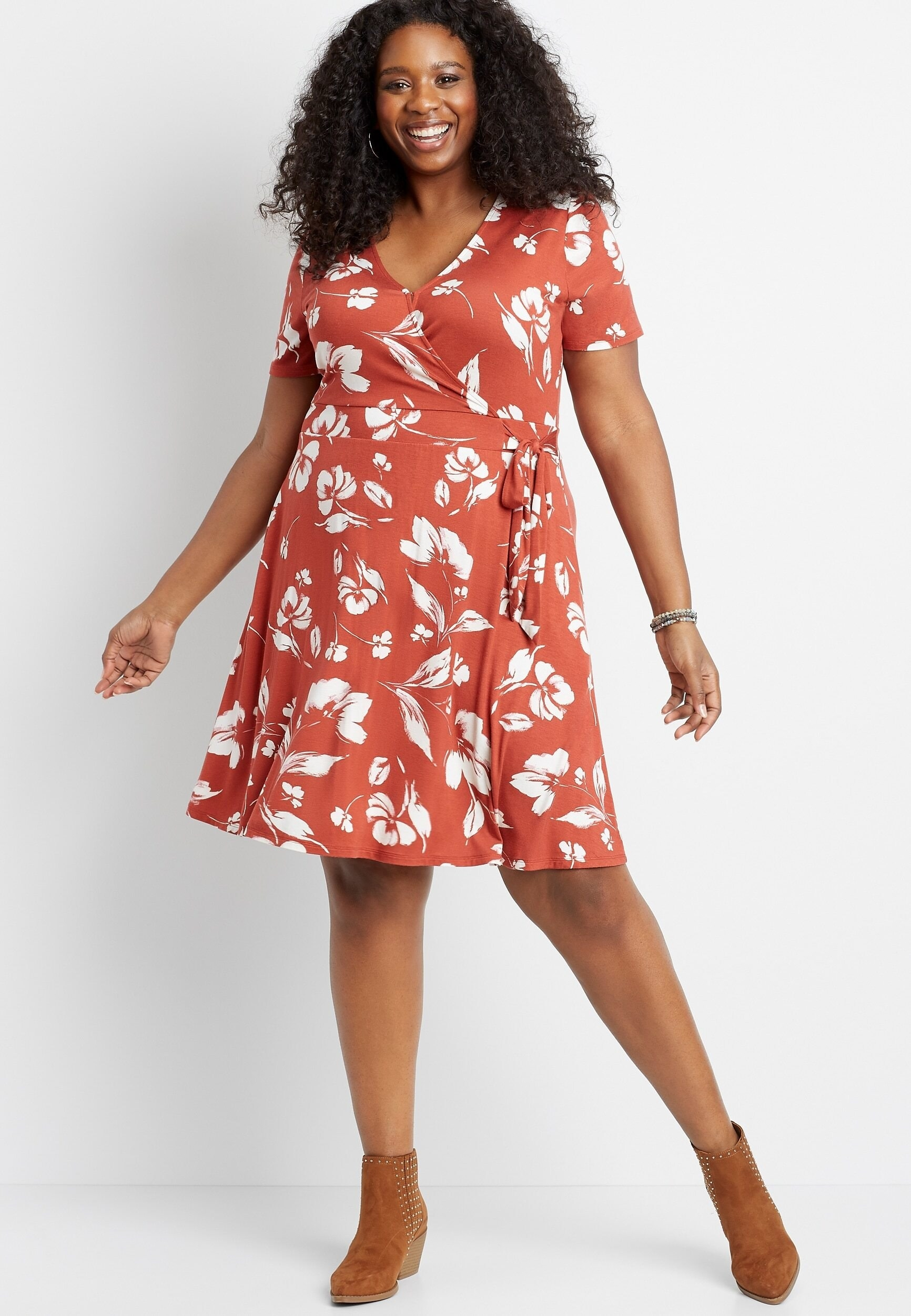 Cap sleeve mini dress with floral pattern on plus size model