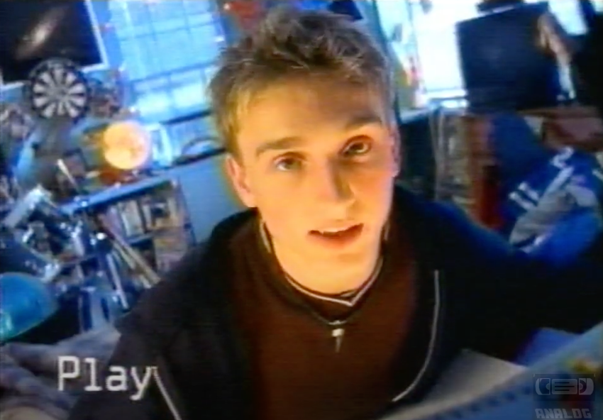 The Dell Guy looking to the camera as he records himself in his bedroom with a camcorder